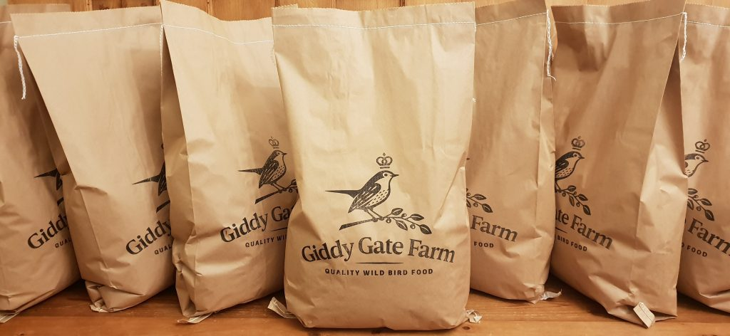 Paper sacks containing bird food from Giddy Gate Farm