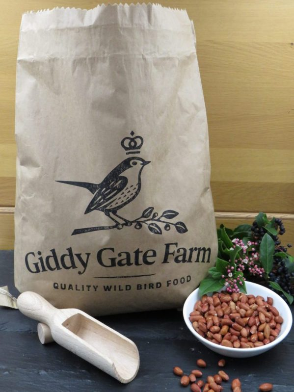 Peanuts for wild bird feeding. recyclable packaging in paper sacks
