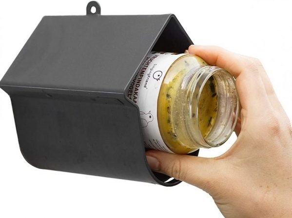 Evie wild bird feeder for large suet logs or bird peanut butter. Showing front panel is easily removed to slide jar inside