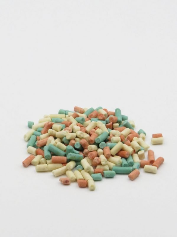Rainboe suet pellets for wild bird feeding. pile of appl, peanut, berry mixed pellets on white background