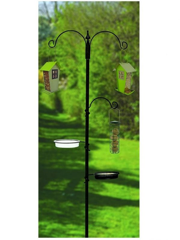 Supa wild bird feeding station pictured in a garden with feeders hanging from 3 hooks. Water dish and tray feeder.