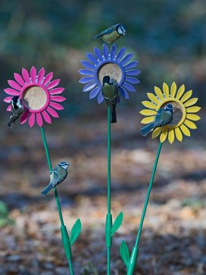 Flutter Butter Flowerbed feeders for peanut butter bird food. Yellow pink and lilac