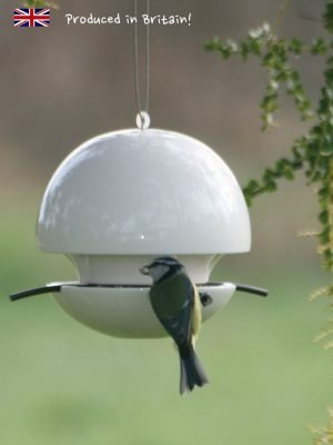 White ceramic Birdball seed feeder for wild birds with blue tit perched