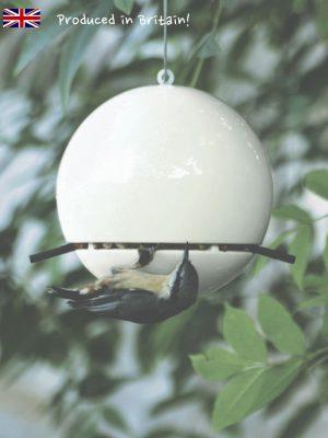 White ceramic Birdball peanut bird feeder for wild birds with nuthatch feeding